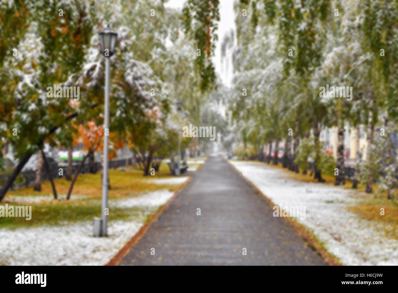 City alley with the first snow - blurred abstract image - Stock Image