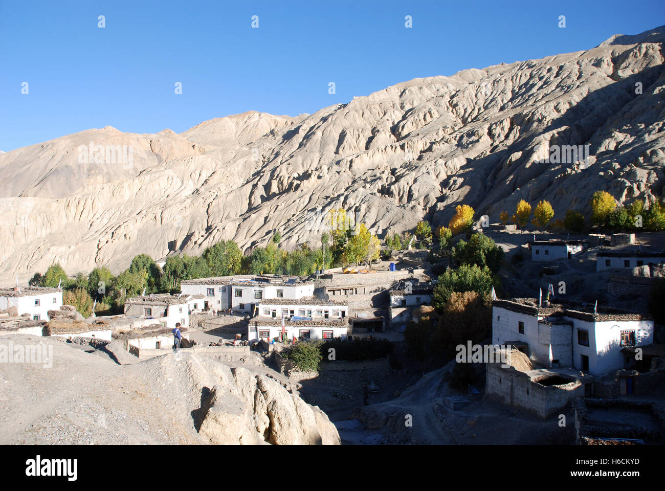 the village of Tangge in the Barren mountain landscape of the remote Damodar Himal in the Mustang region of Nepal - Stock Image