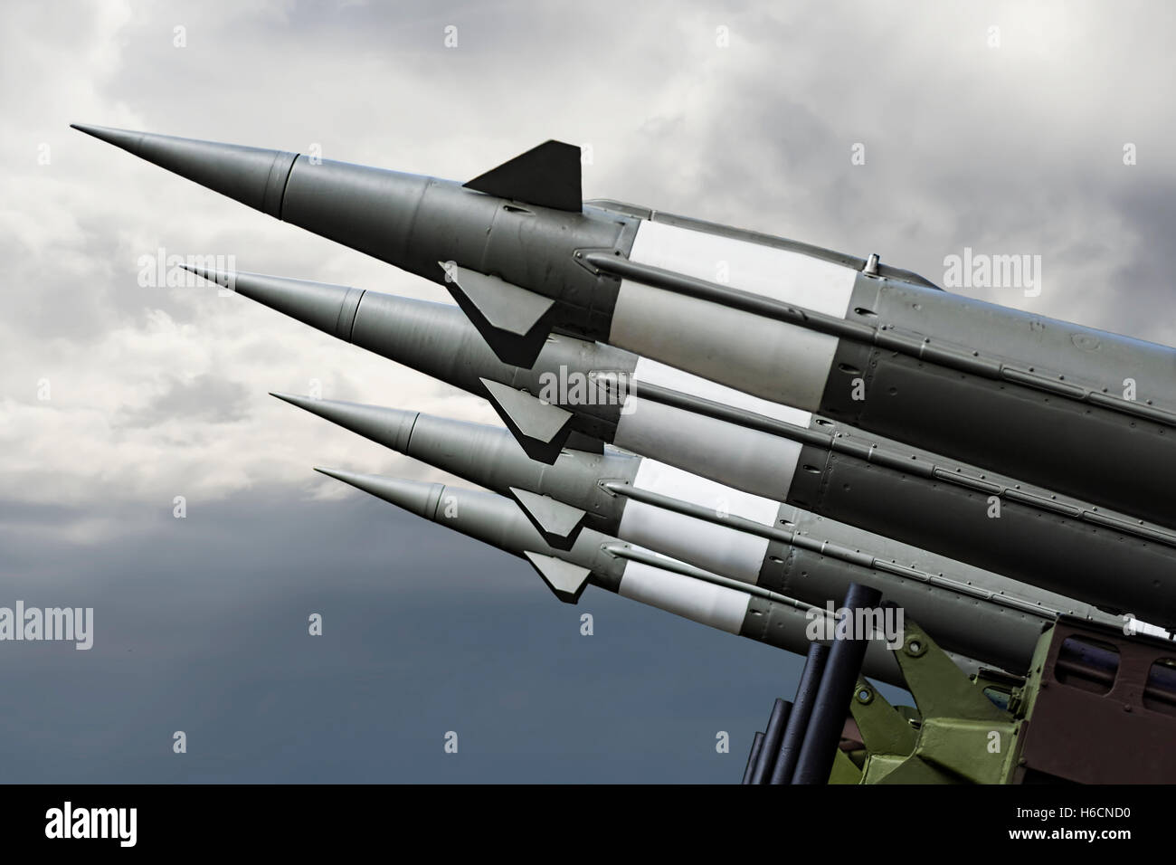 Nuclear Missiles With Warhead Aimed at Gloomy Sky. Balistic Rockets War Background. - Stock Image