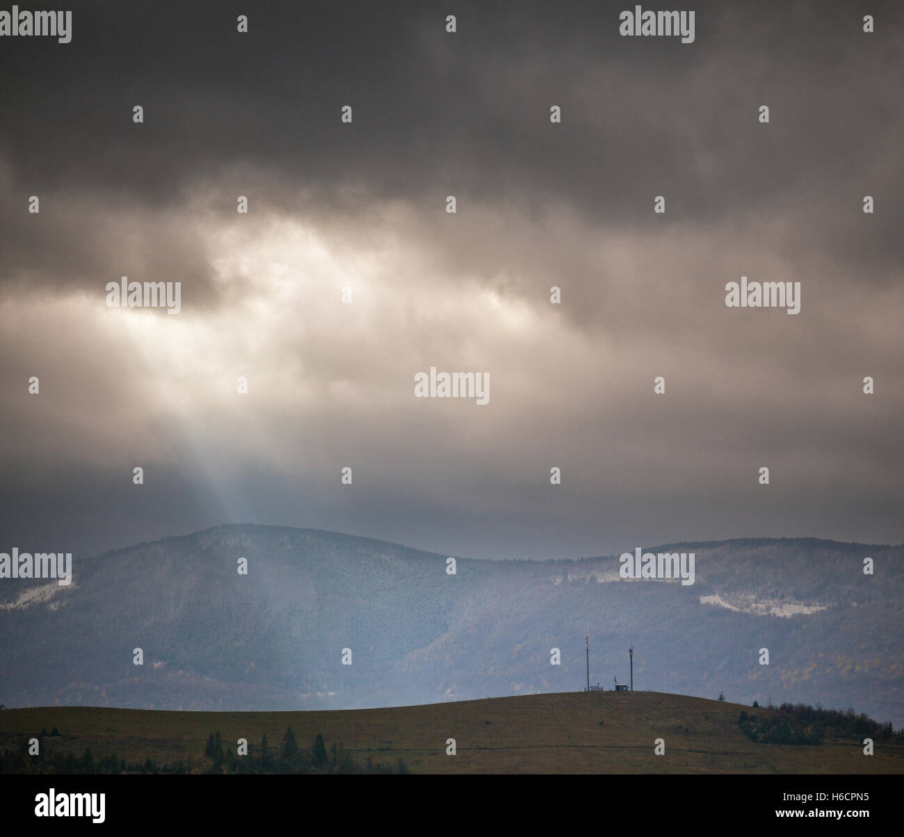 Overcast scene in cloudy mountains. November rain - Stock Image