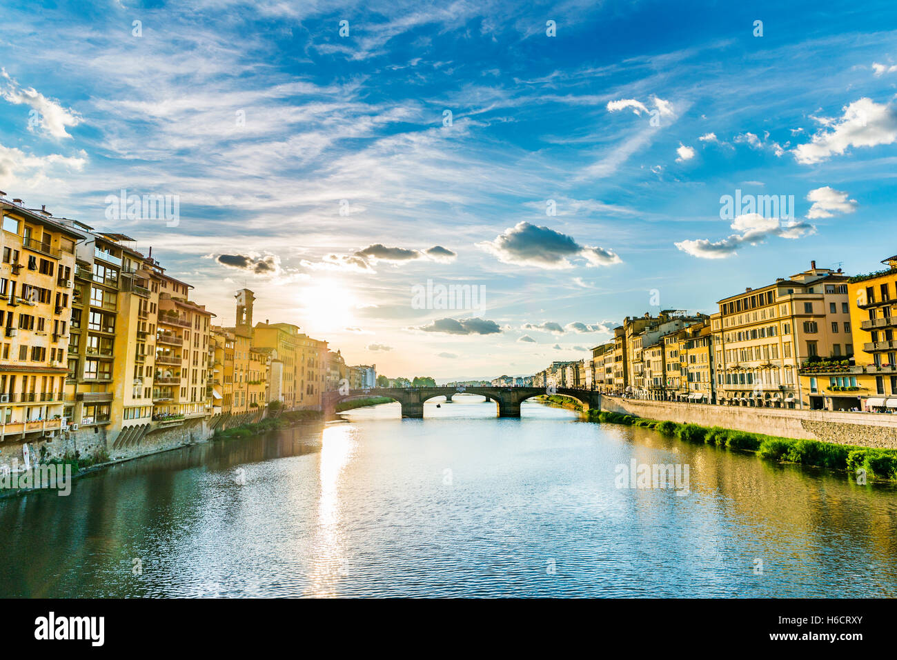 View of Ponte Santa Trinita bridge from Ponte Vecchio over Arno River, Florence, Tuscany, Italy - Stock Image