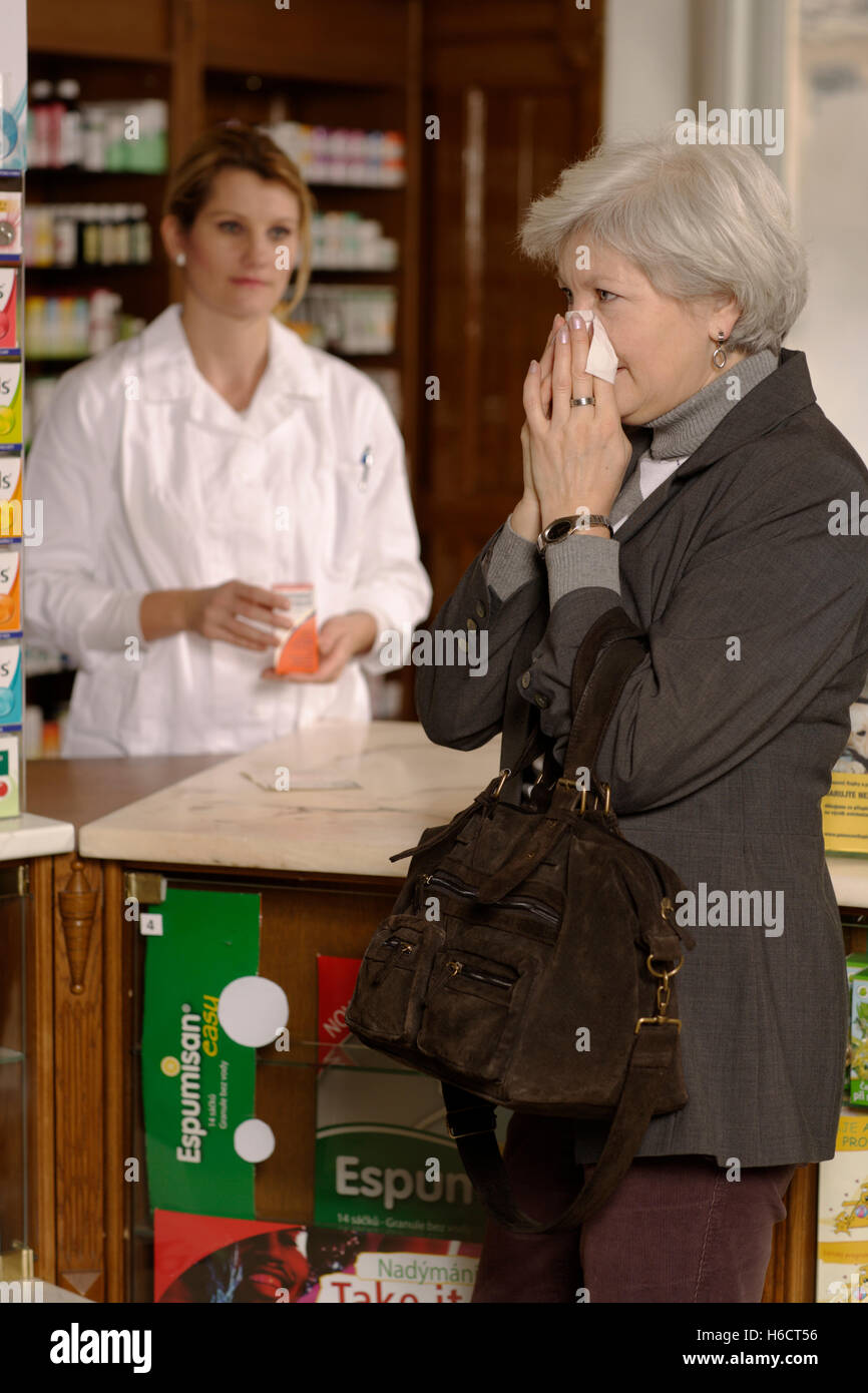 Pharmacy, pharmacist, customer - Stock Image