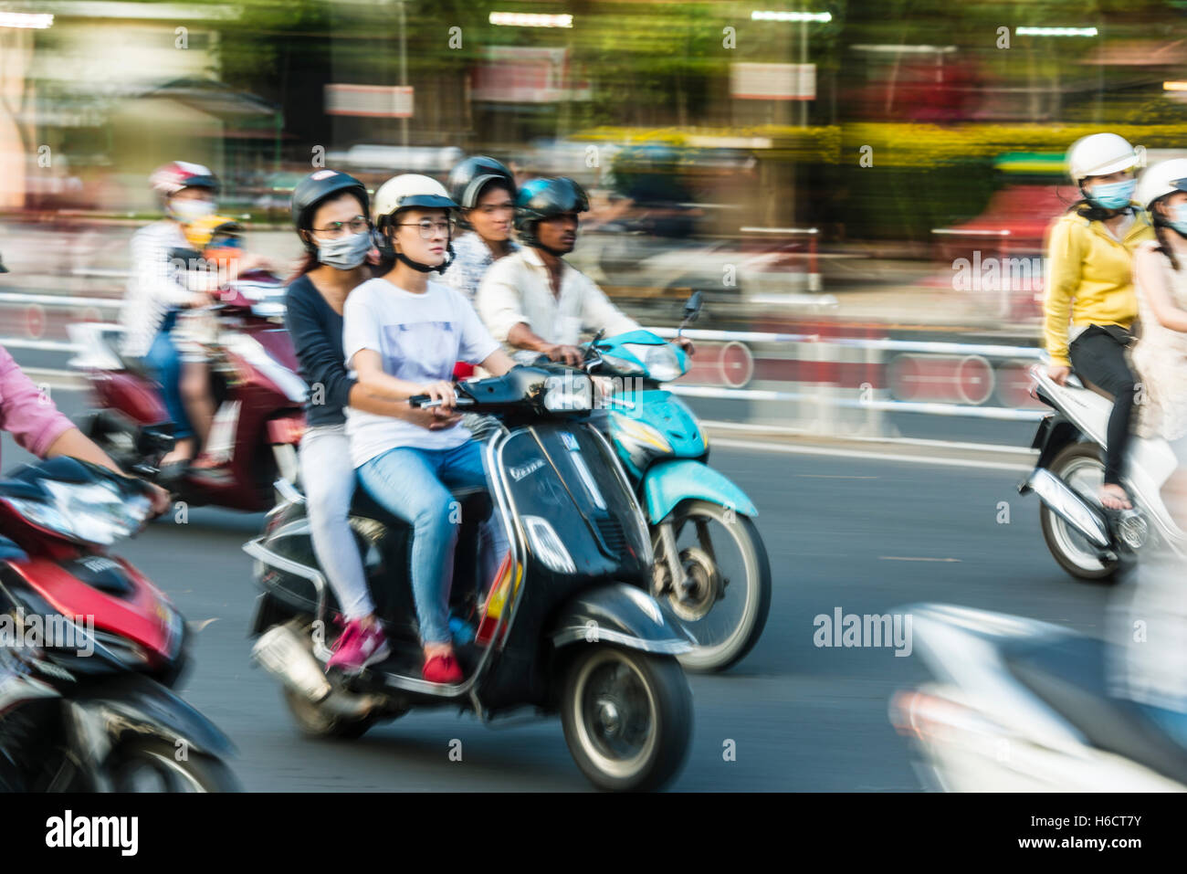 Scooter drivers in heavy traffic, motion blur, Ho Chi Minh City, Vietnam - Stock Image