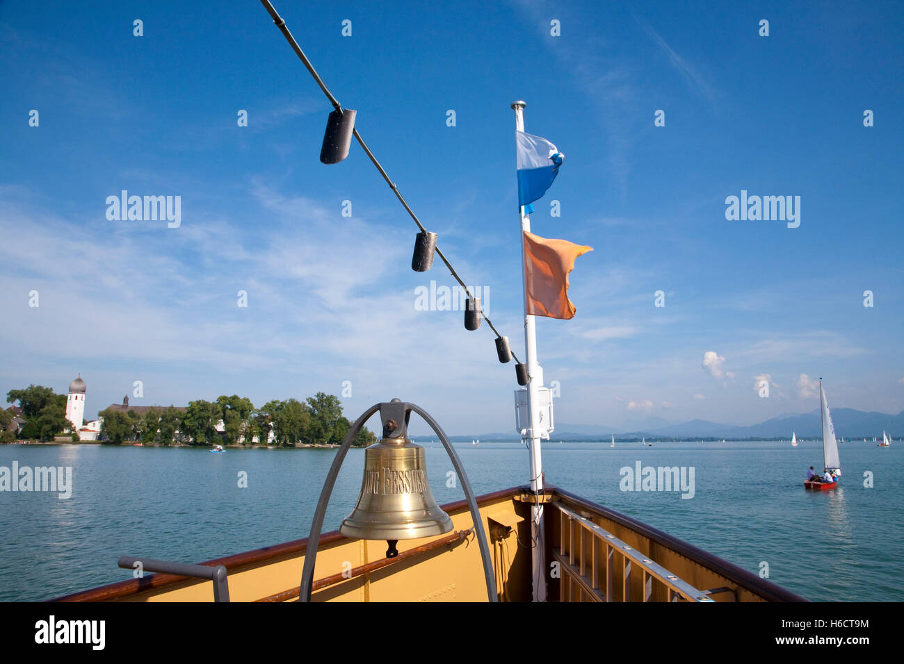 Monastery on Insel Frauenchiemsee island, bow of the ship Ludwig Fessler, ship's bell, sailboat, sailing, Chiemsee - Stock Image