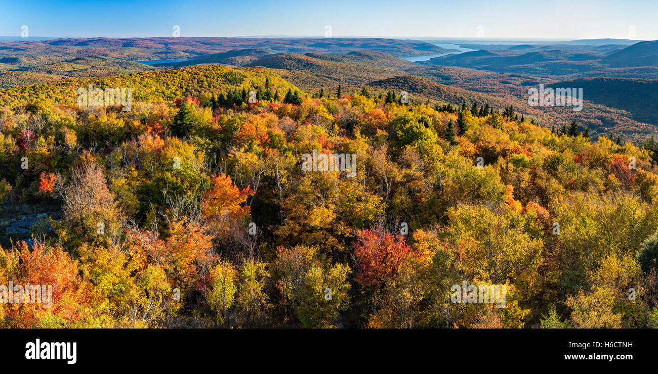 Colorful Autumn panoramic view south over the Great Sacandaga Lake from the Hadley Mountain fire tower in the Adirondacks - Stock Image