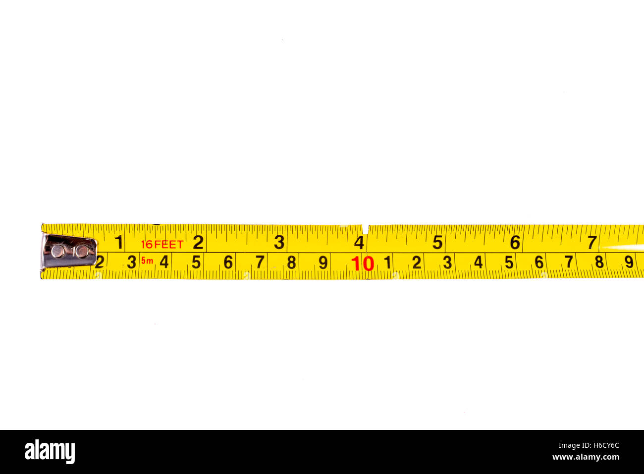 A close-up shot of a tape measure ruler over a white background. - Stock Image