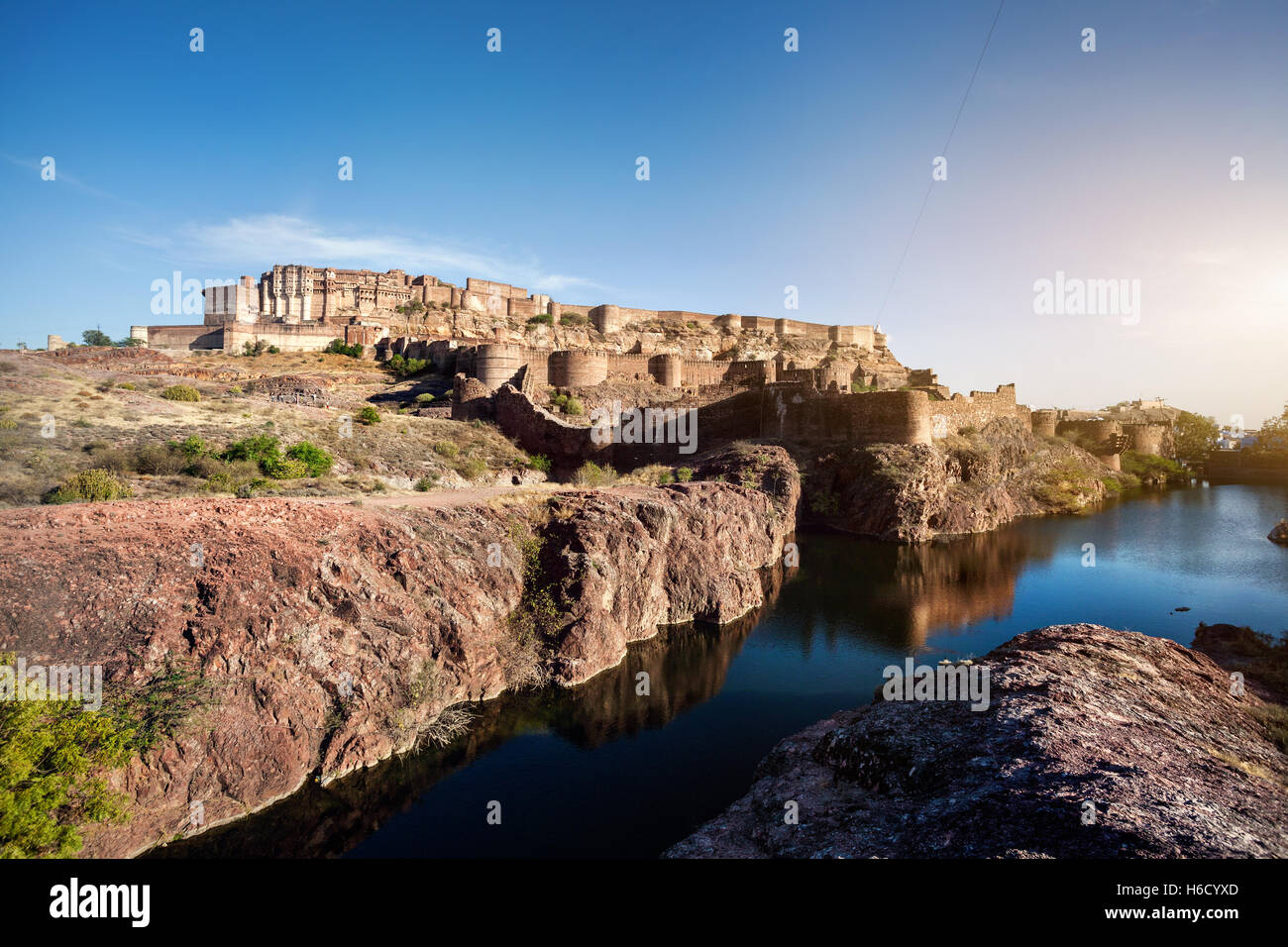 Mehrangarh fortress in the dessert and pound Jodhpur blue city, Rajasthan, India - Stock Image