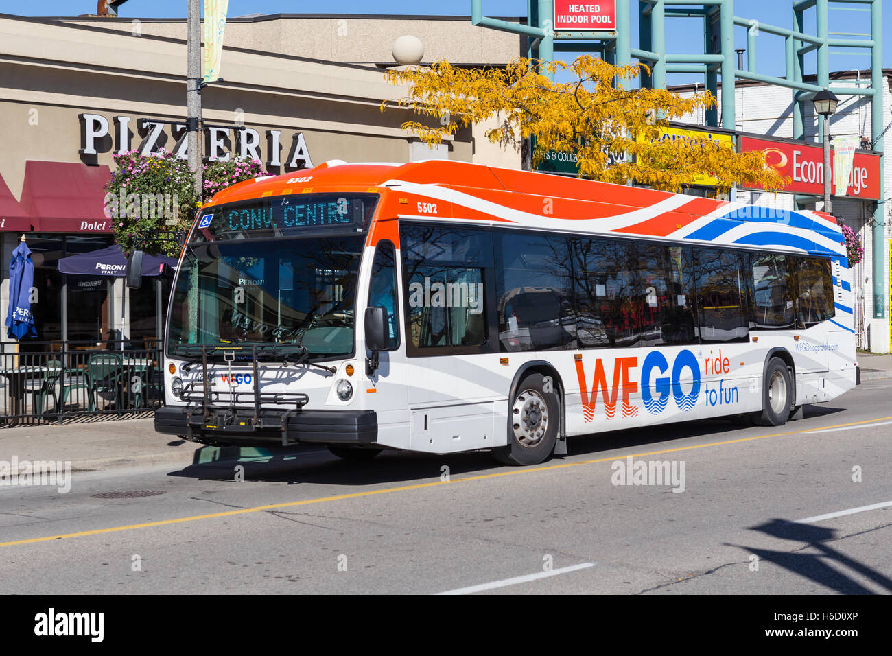 A WEGO bus heads down Victoria Avenue on its route to the Convention Center in Niagara Falls, Ontario, Canada. - Stock Image