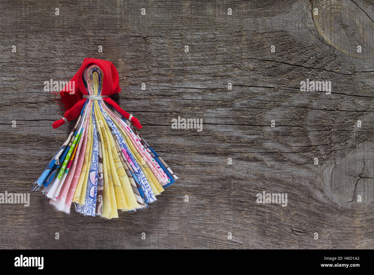 Slavic talisman doll. Russian traditional rag doll handmade. Top view, copy space. Sewing crafts. Stock Photo