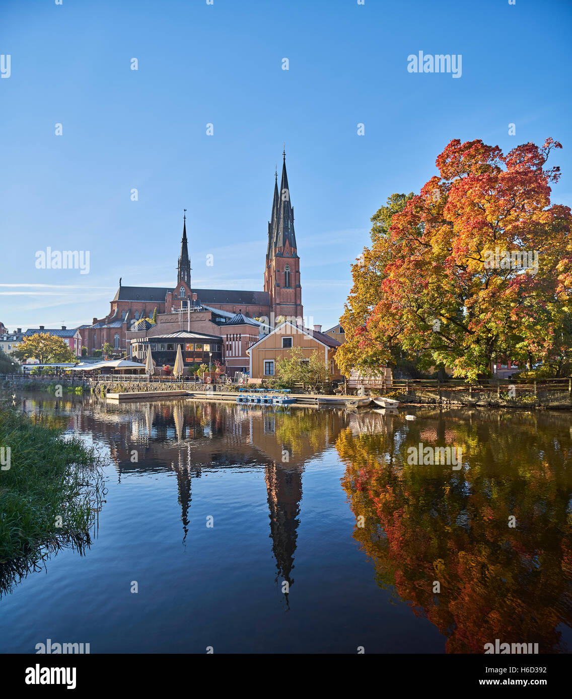 The Cathedral and the Fyris river (Fyrisan) in the autumn, Uppsala, Sweden, Scandinavia Stock Photo