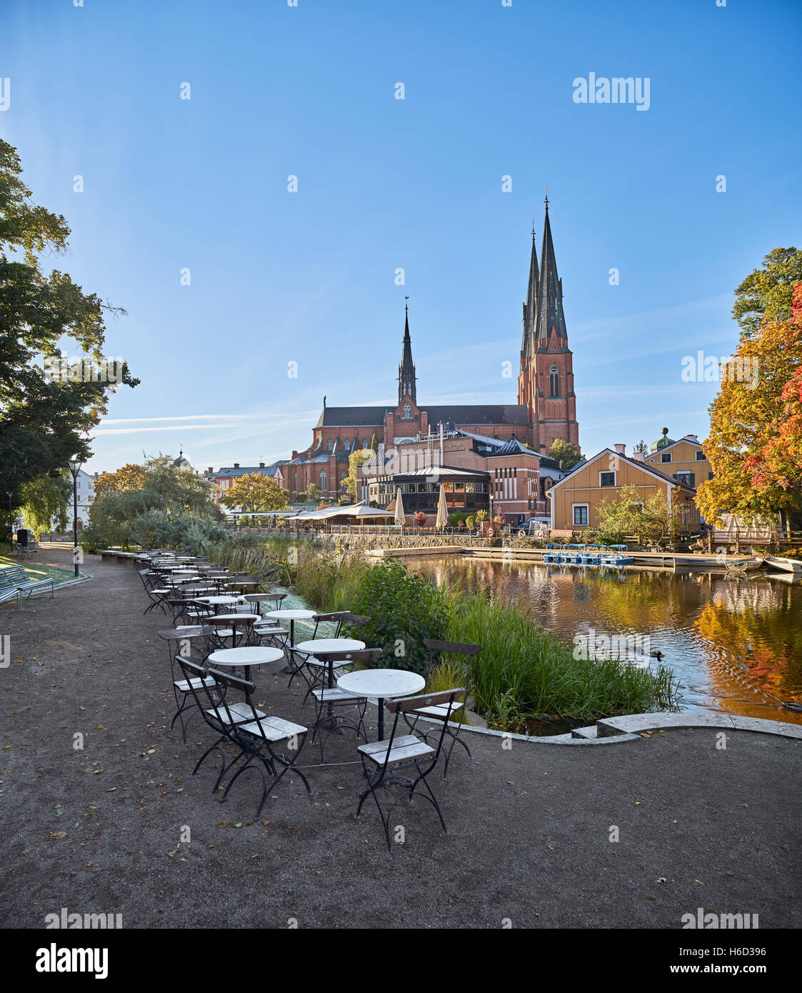 The Cathedral and the Fyris river (Fyrisan) in the autumn, Uppsala, Sweden, Scandinavia - Stock Image