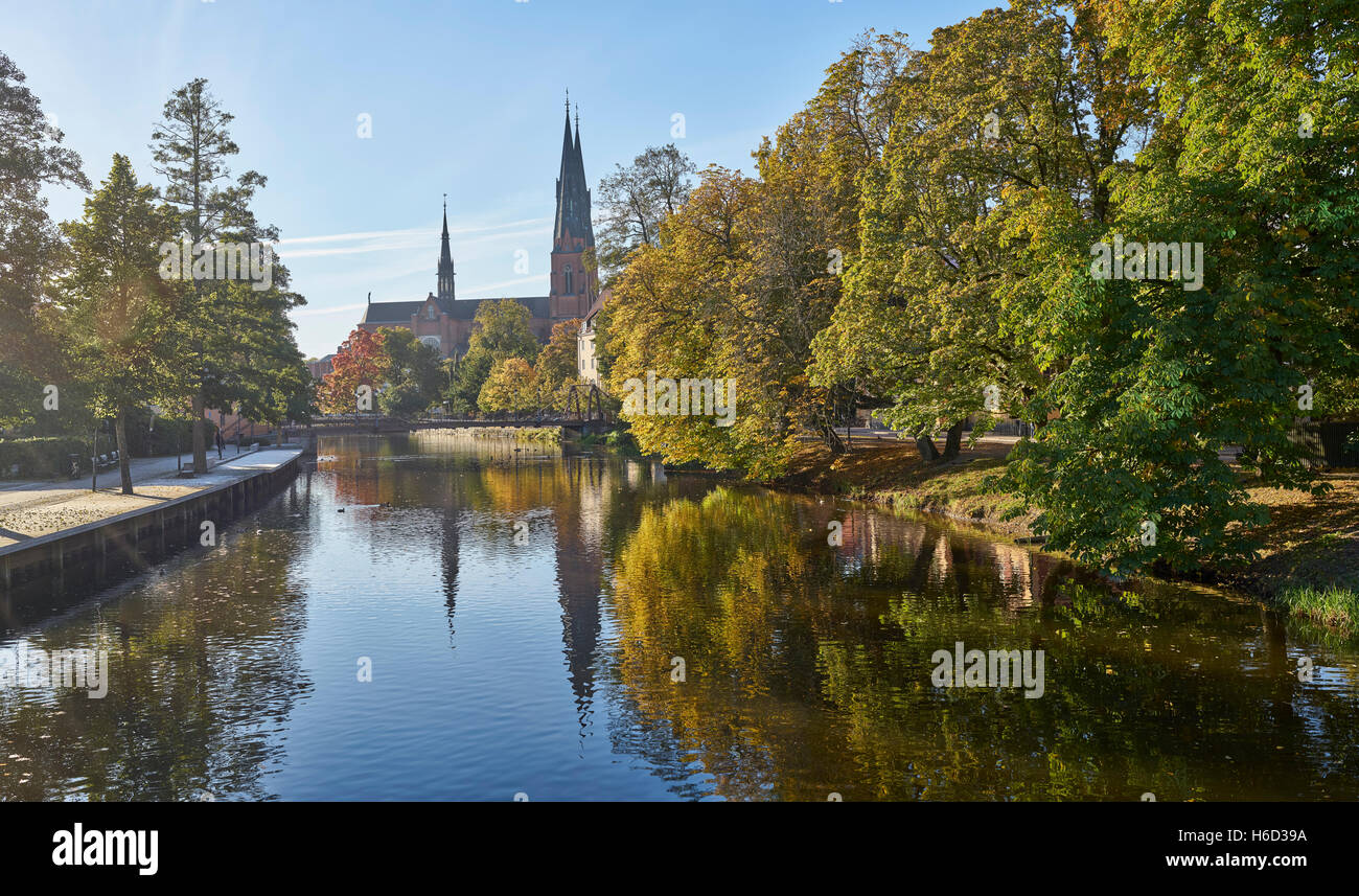 The Cathedral and the Fyris river in the autumn with the Jernbron (Iron Bridge) in the foreground, Uppsala, Sweden, - Stock Image