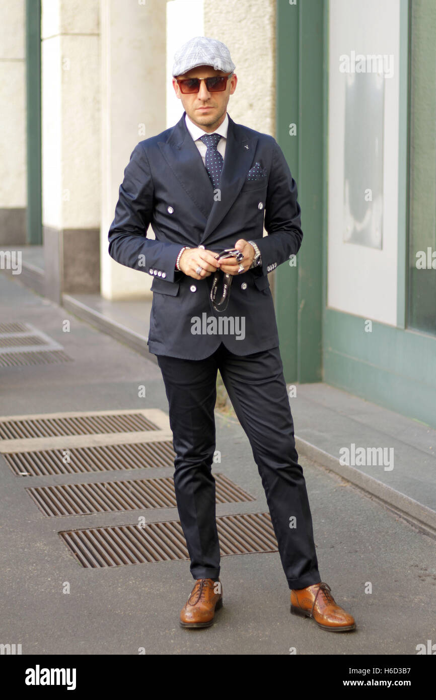Amos Partemi posing outside the Salvatore Ferragamo Spring/Summer 2017 show during Milan Fashion Week in Milan, Stock Photo