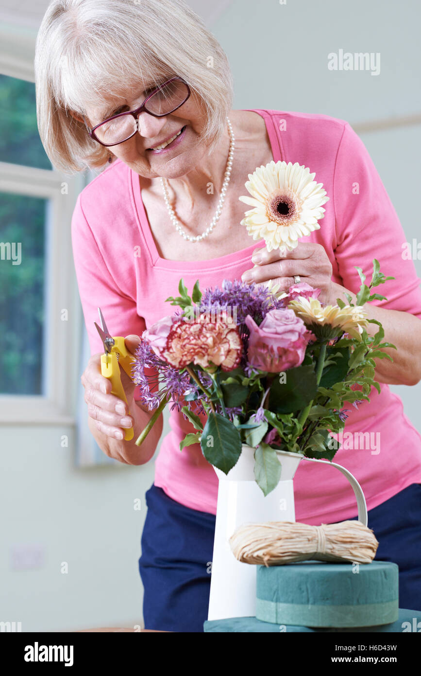 Senior Woman In Flower Arranging Class Stock Photo