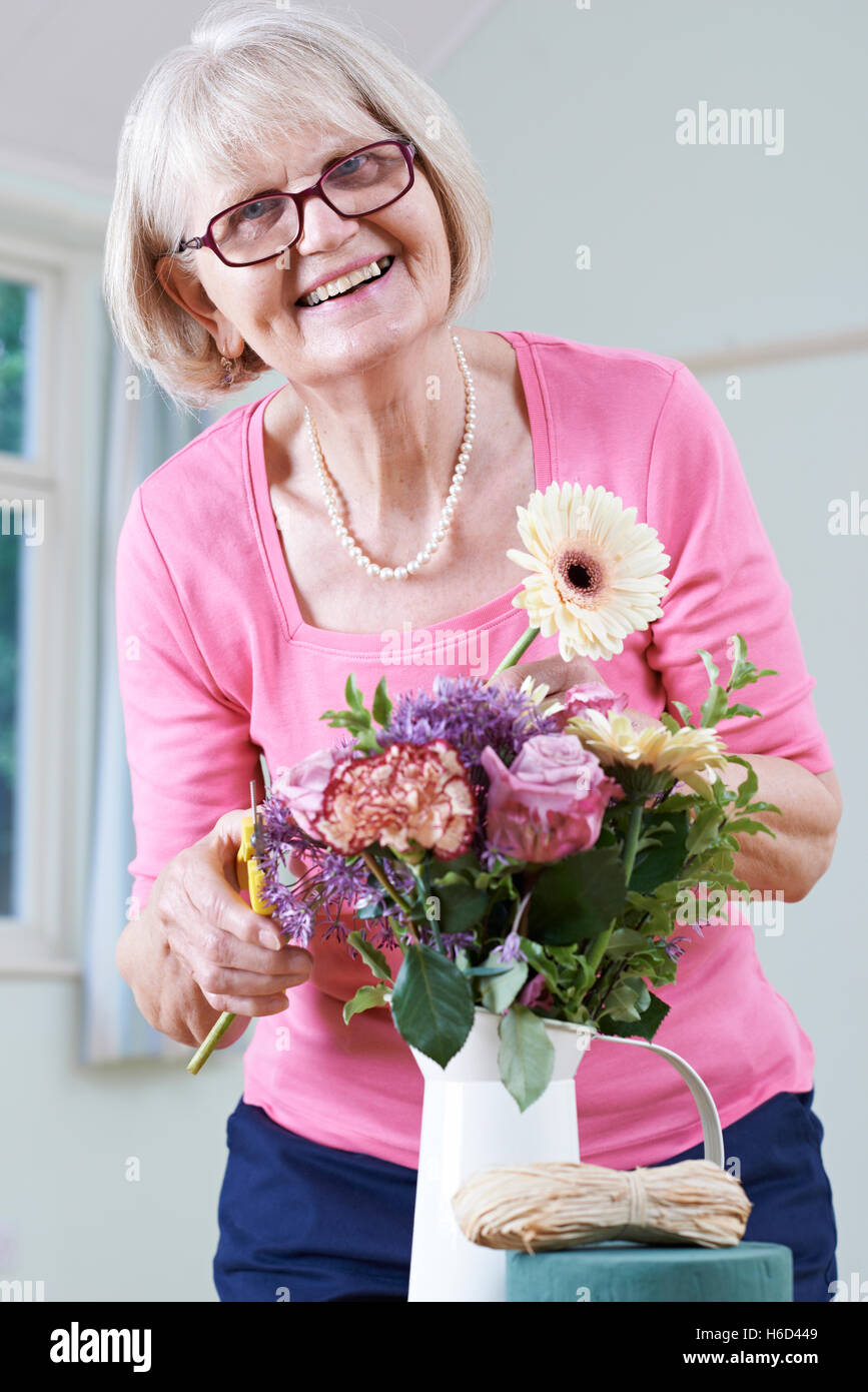 Senior Woman In Flower Arranging Class - Stock Image