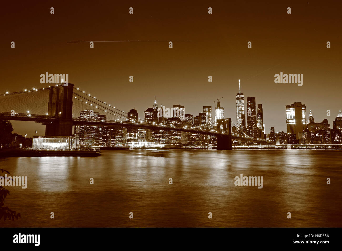 Sepia tones black & white evening view of Brooklyn Bridge from Main Street Park, Dumbo, Brooklyn, NY, United States. Stock Photo
