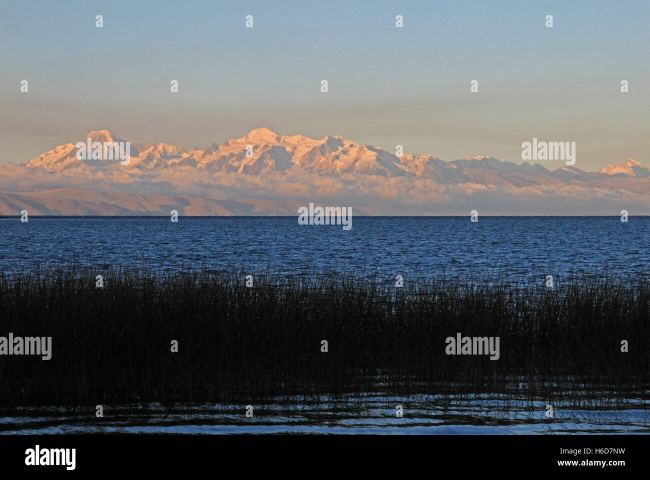 Cordillera real mountain range at sunset behind Titicaca lake Stock Photo