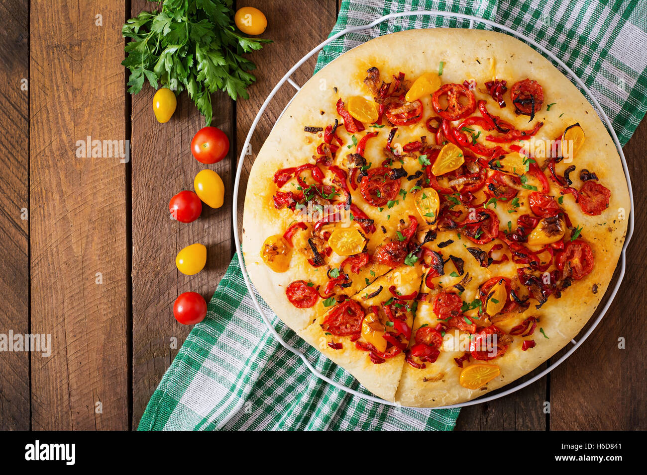 Italian focaccia with tomatoes, peppers and onions - Stock Image