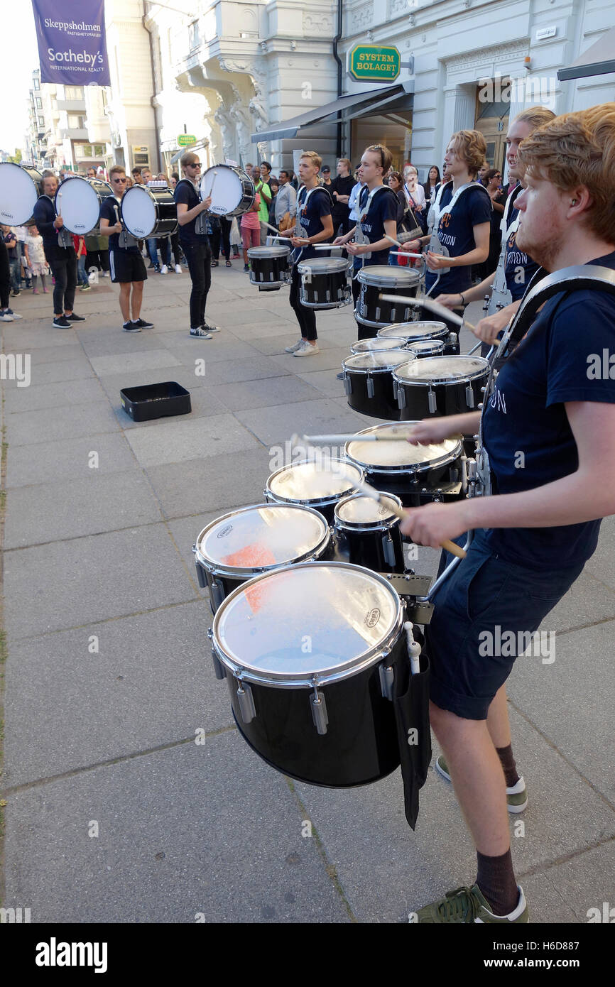 Drummer band is performing on the Avenue street of Gothenburg, Sweden. - Stock Image
