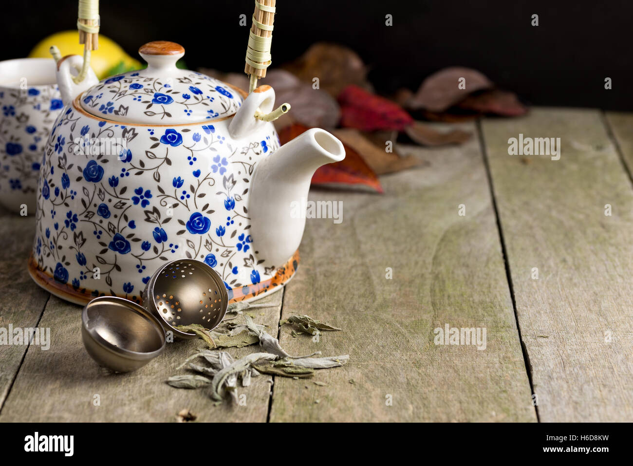 Autumn cup of tea on a rustic wooden table. - Stock Image
