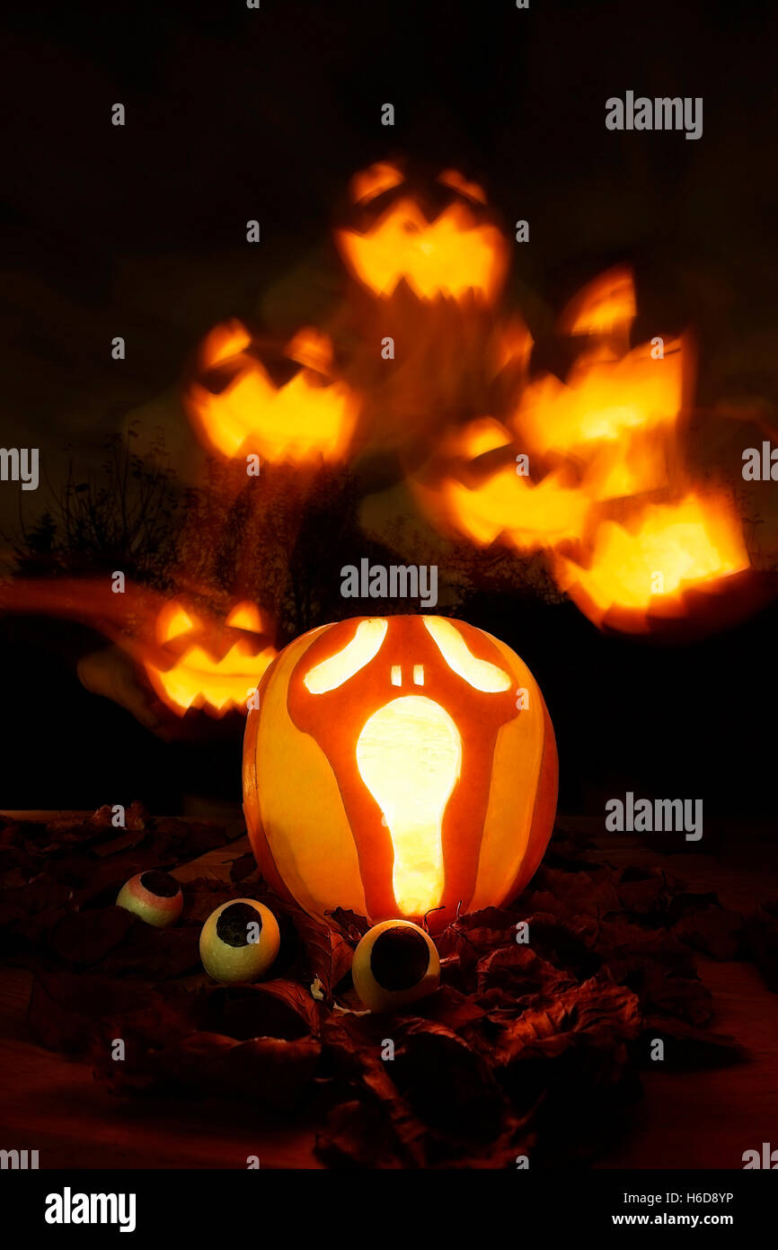 scary halloween pumpkins eyes glowing stock photos & scary halloween
