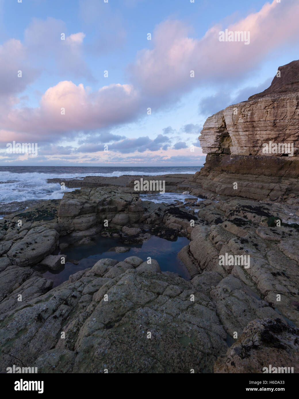 View from the rocks at Thornwick Bay nearing sunset, east Yorkshire, UK Stock Photo