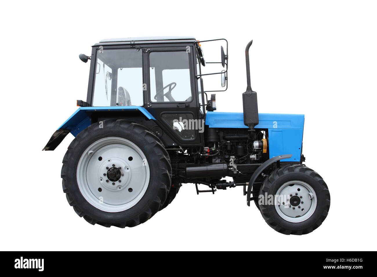 Blue tractor isolated on a white background - Stock Image