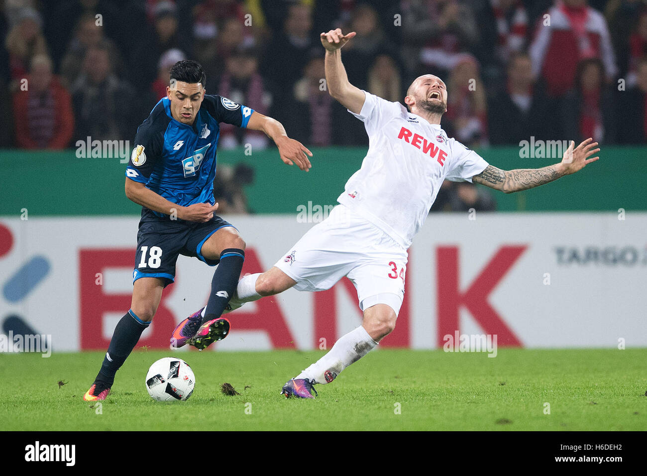 Cologne, Germany. 26th Oct, 2016. Hoffenheim's Nadiem Amiri (L) and FC Cologne's Konstantin Rausch compete - Stock Image