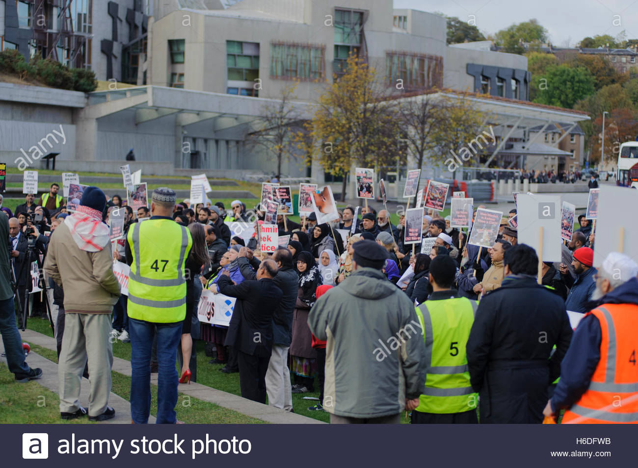 Edinburgh, UK. 27 October, 2016. Large crowd gathers in front of the Scottish Parliament to protest at the Indian - Stock Image