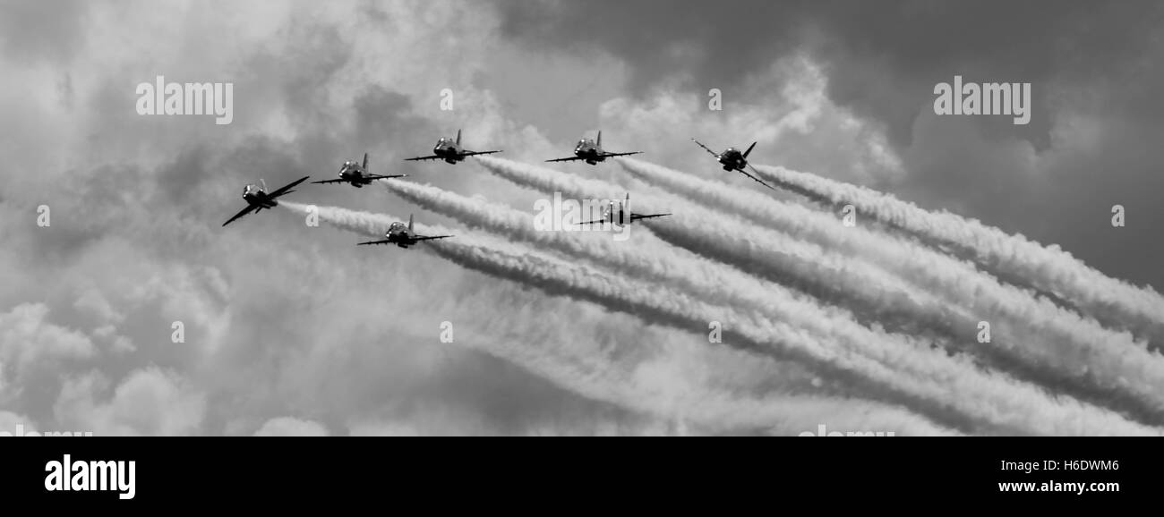 Black and white Red Arrows Breaking to land at Hawarden. - Stock Image