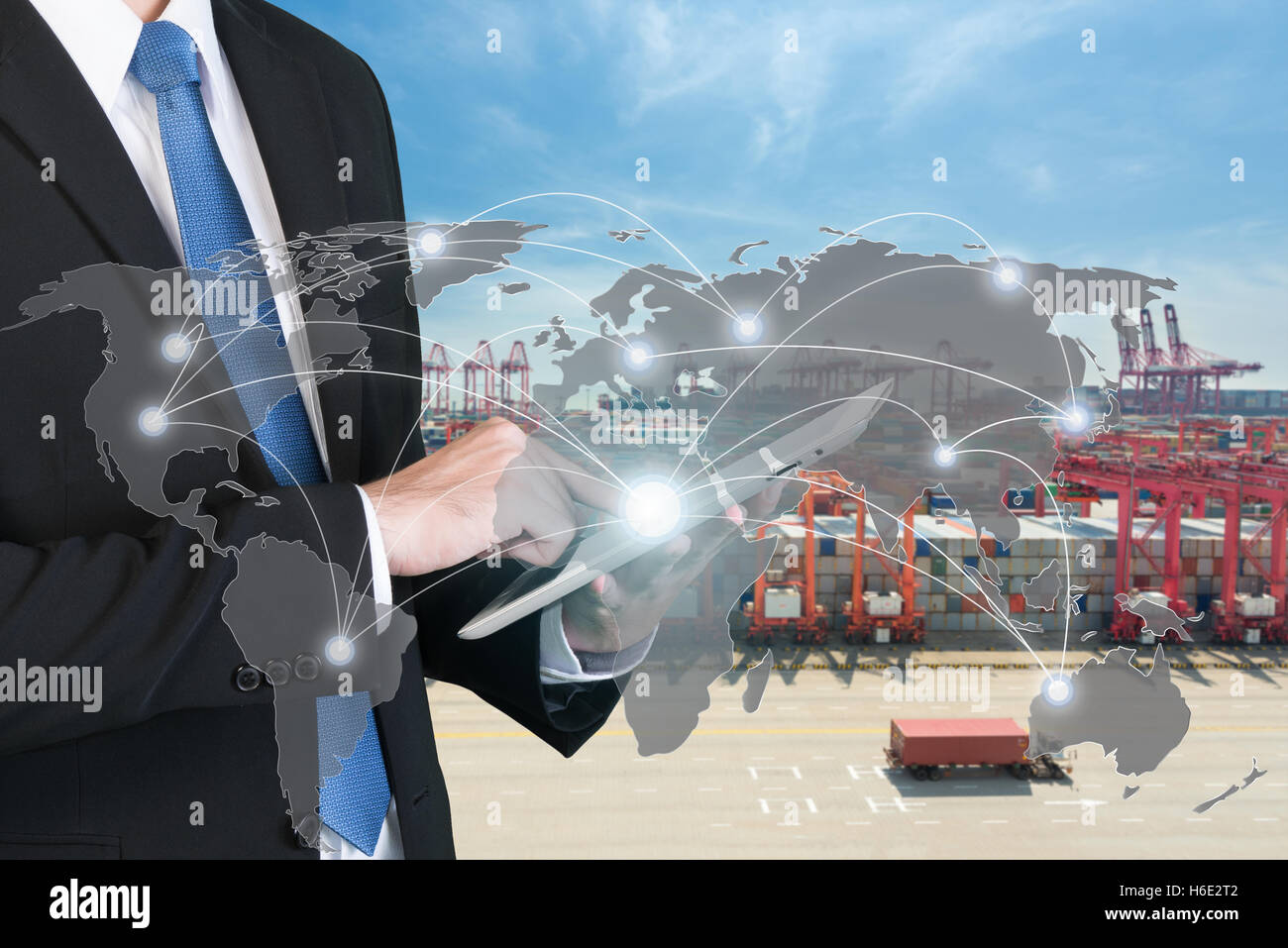 Businessman press digital tablet to show global network partnership connection use for logistics,import,export background Stock Photo