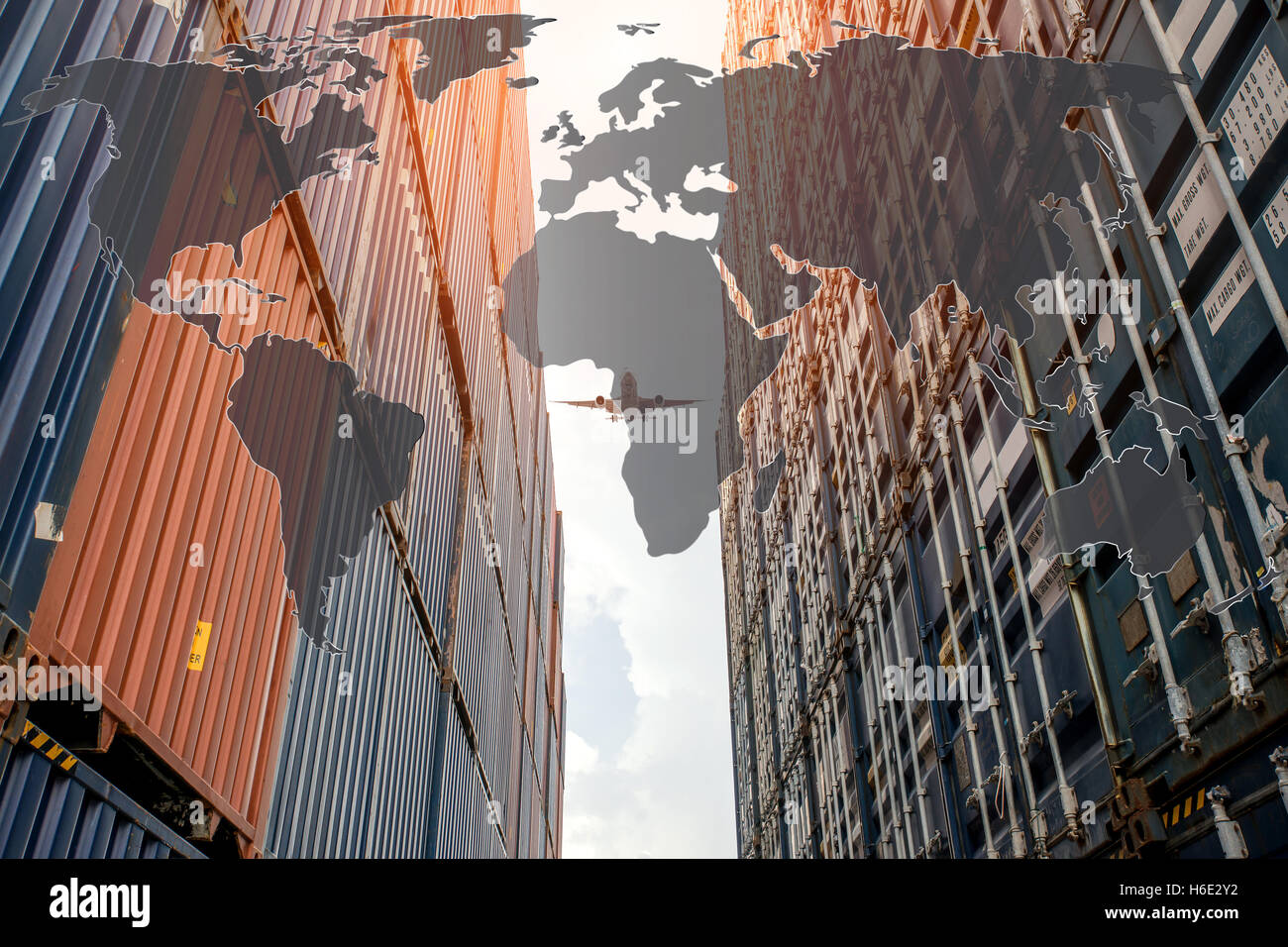 Stack of cargo containers with global map at the docks. Use for cargo container Import, Export, Logistics background - Stock Image