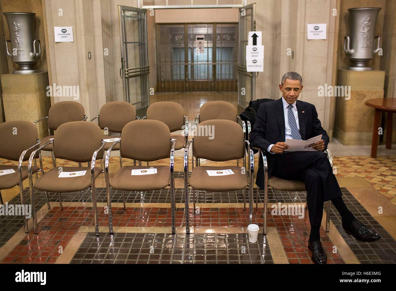 U.S. President Barack Obama reads a program before the portrait unveiling ceremony for Attorney General Eric Holder, - Stock Image