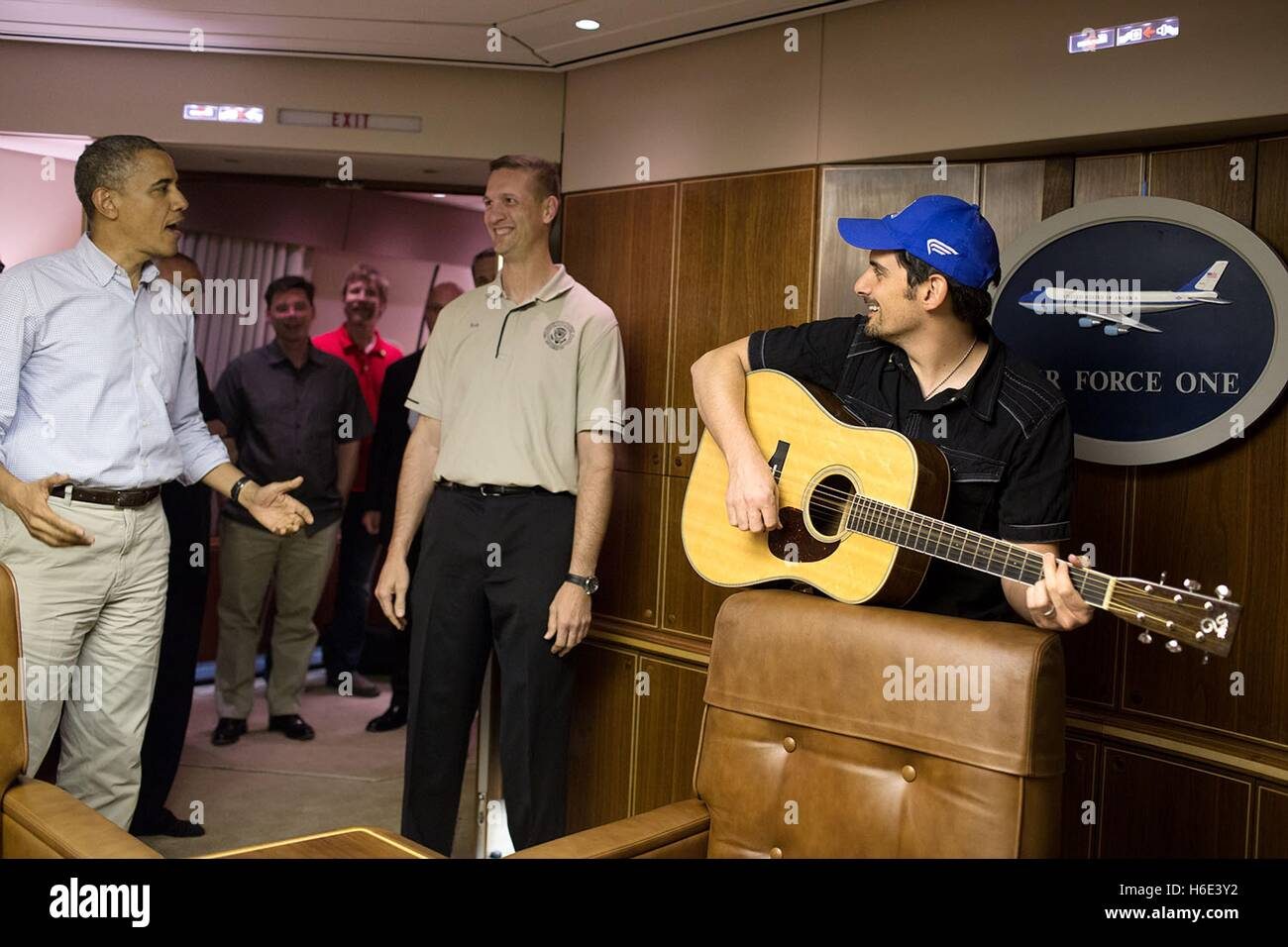 Us president barack obama and country singer brad paisley sing us president barack obama and country singer brad paisley sing presidential flight attendants superintendent rob nation a happy birthday aboard air force m4hsunfo
