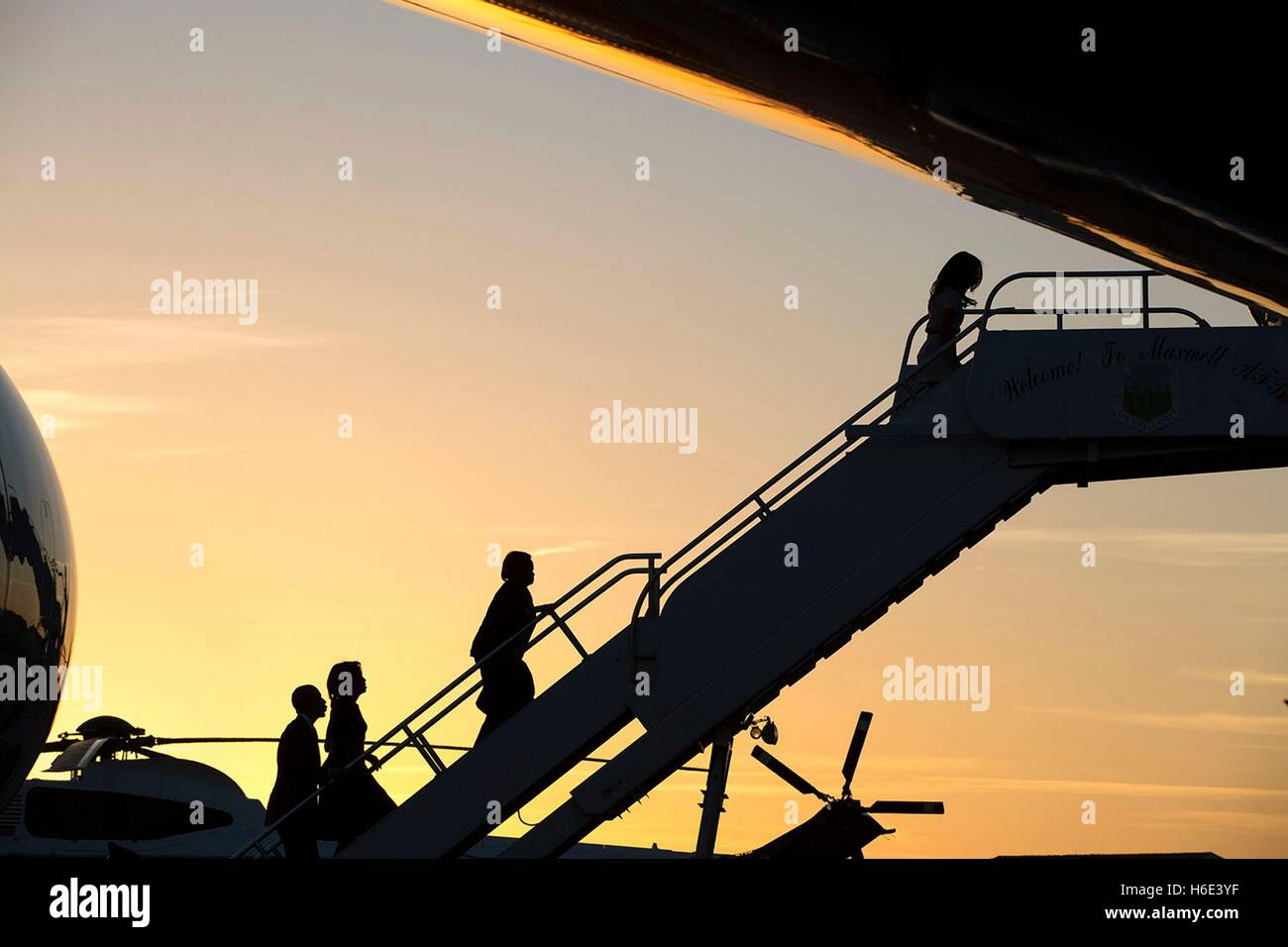 U.S. President Barack Obama and First Lady Michelle Obama board Air Force One at sunset at the Maxwell Air Force - Stock Image