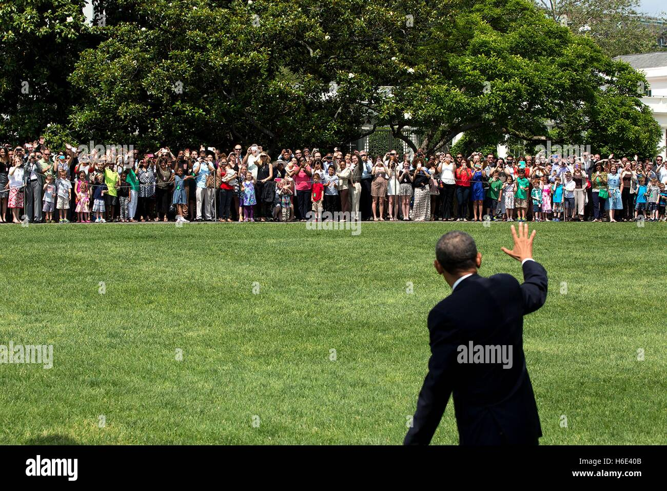 U.S. President Barack Obama waves to guests on the White House South Lawn upon arrival May 28, 2014 in Washington, - Stock Image