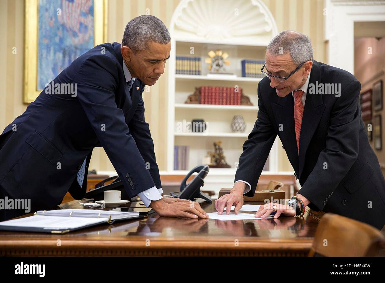 U.S. President Barack Obama and presidential Counselor John Podesta meet in the White House Oval Office January - Stock Image