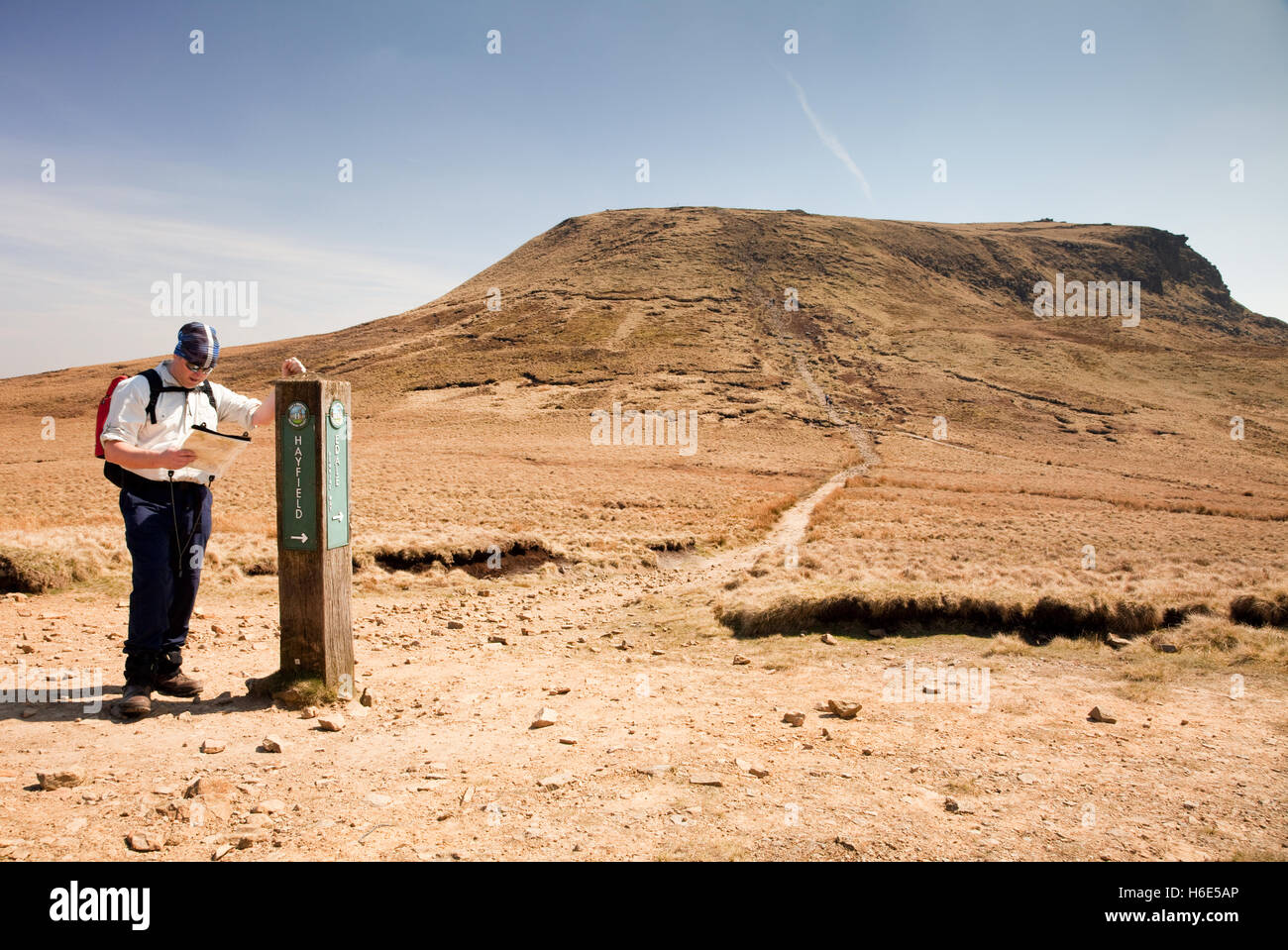 A hill-walker at the base of Kinder Scout in the Peak District - Stock Image
