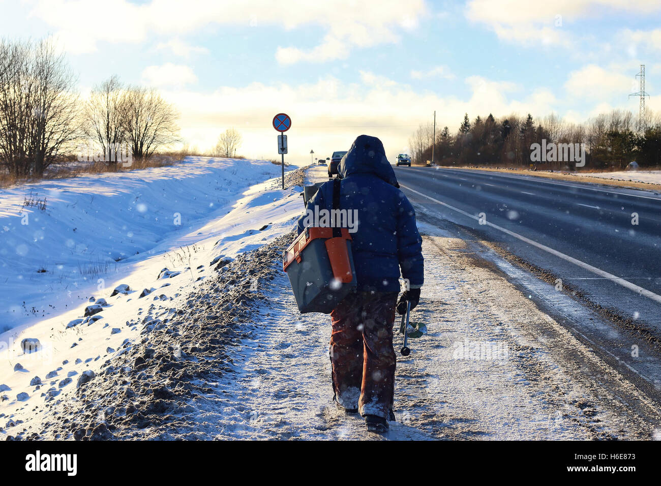 Winter fisherman walk fishing Stock Photo