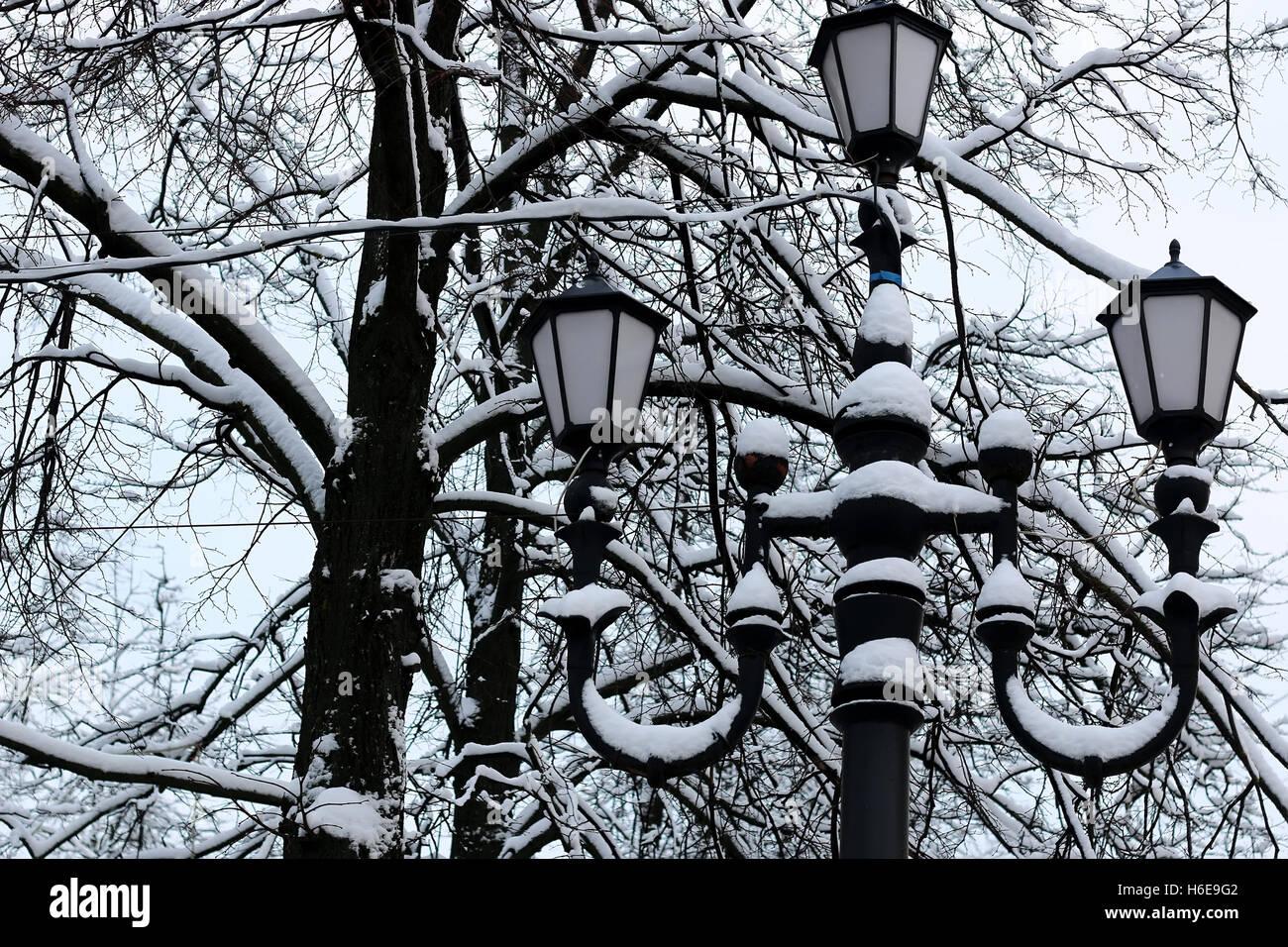 black wrought iron lamp winter - Stock Image