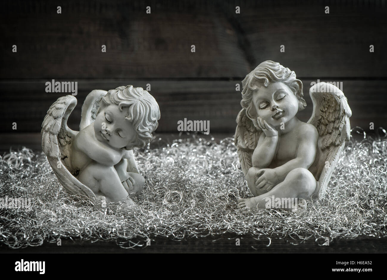 Guardian angel. Christmas decoration. Slipping child. Vintage style toned photo - Stock Image