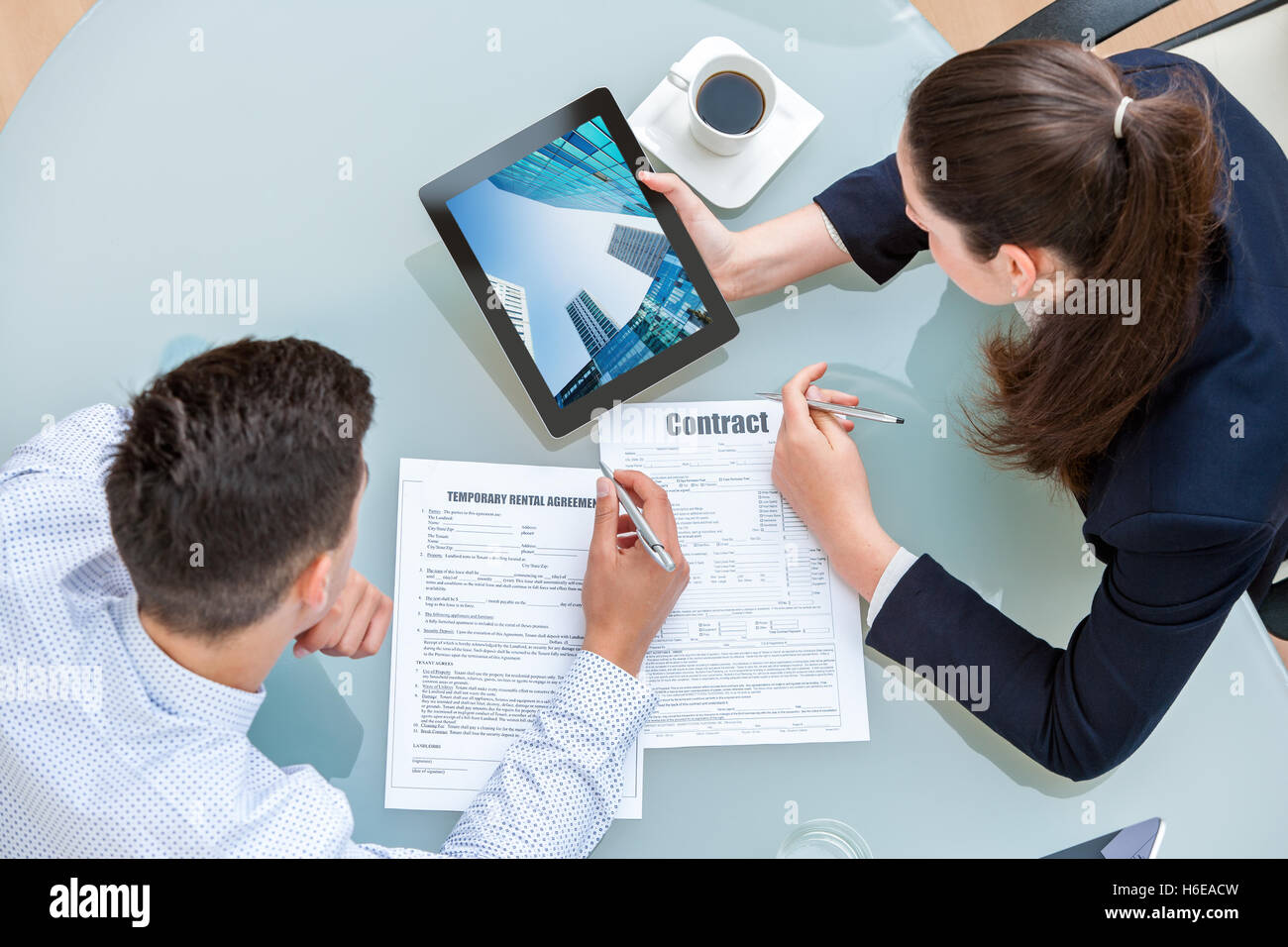 Young Business Couple Discussing Rental Agreement Woman