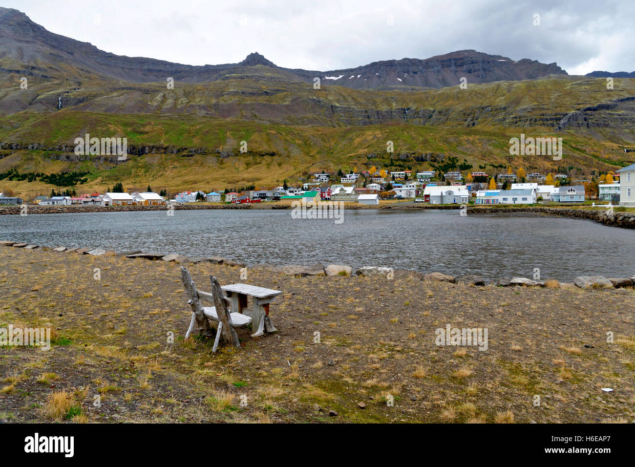 Old wooden table setting, Seydisfjordur, East Iceland, North Atlantic, Europe - Stock Image