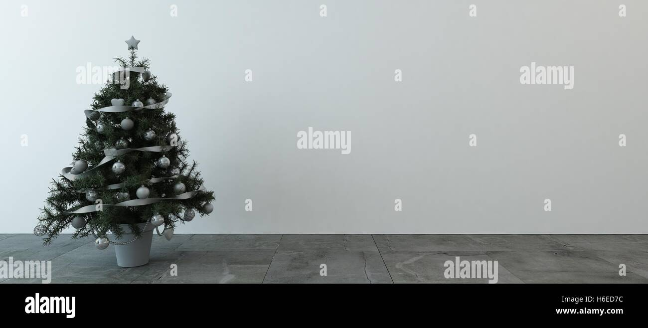 Little green indoor Christmas tree decorated with neutral colored ...
