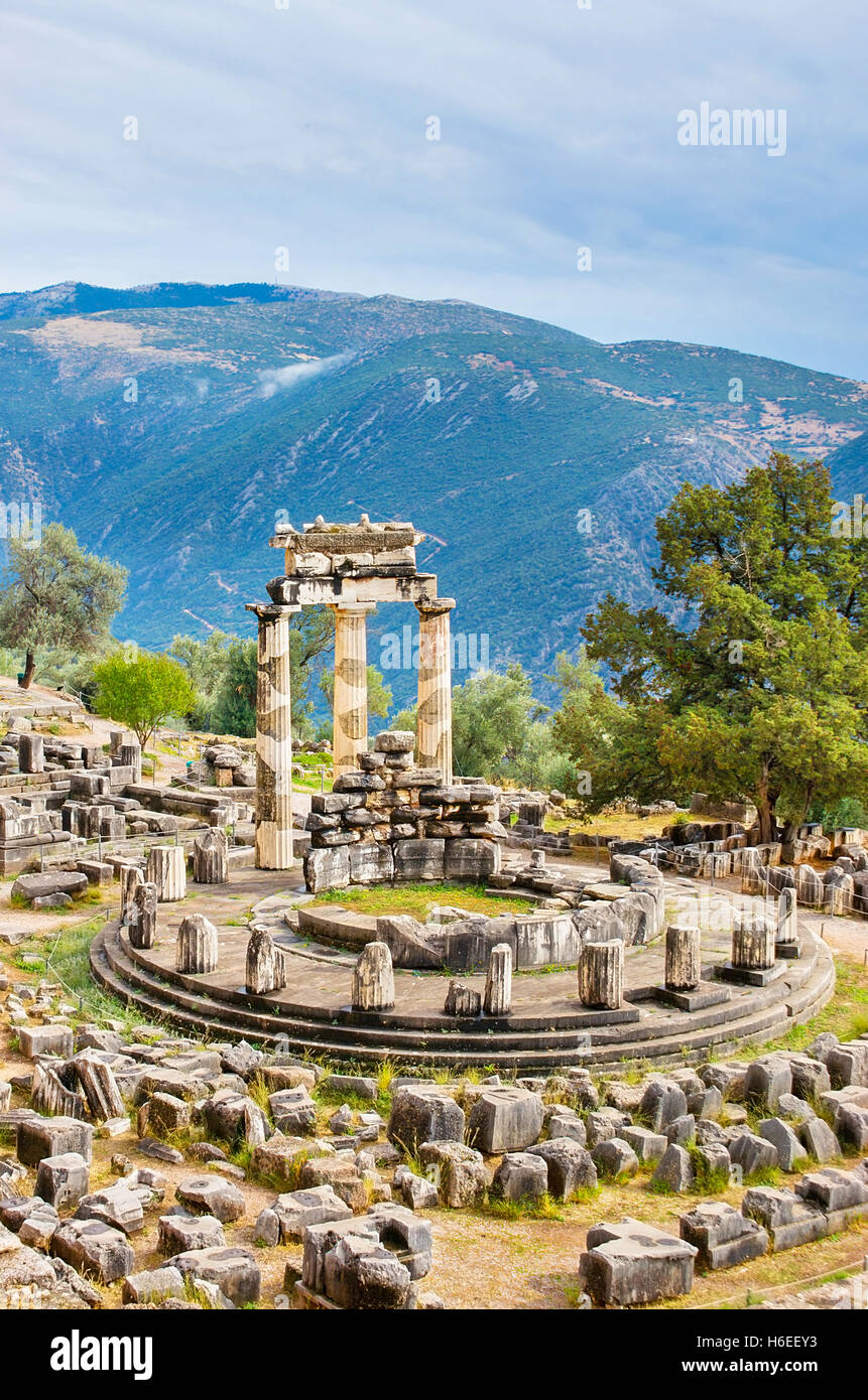 The Tholos at the sanctuary of Athena Pronoia is a circular building with three restored Doric columns Stock Photo