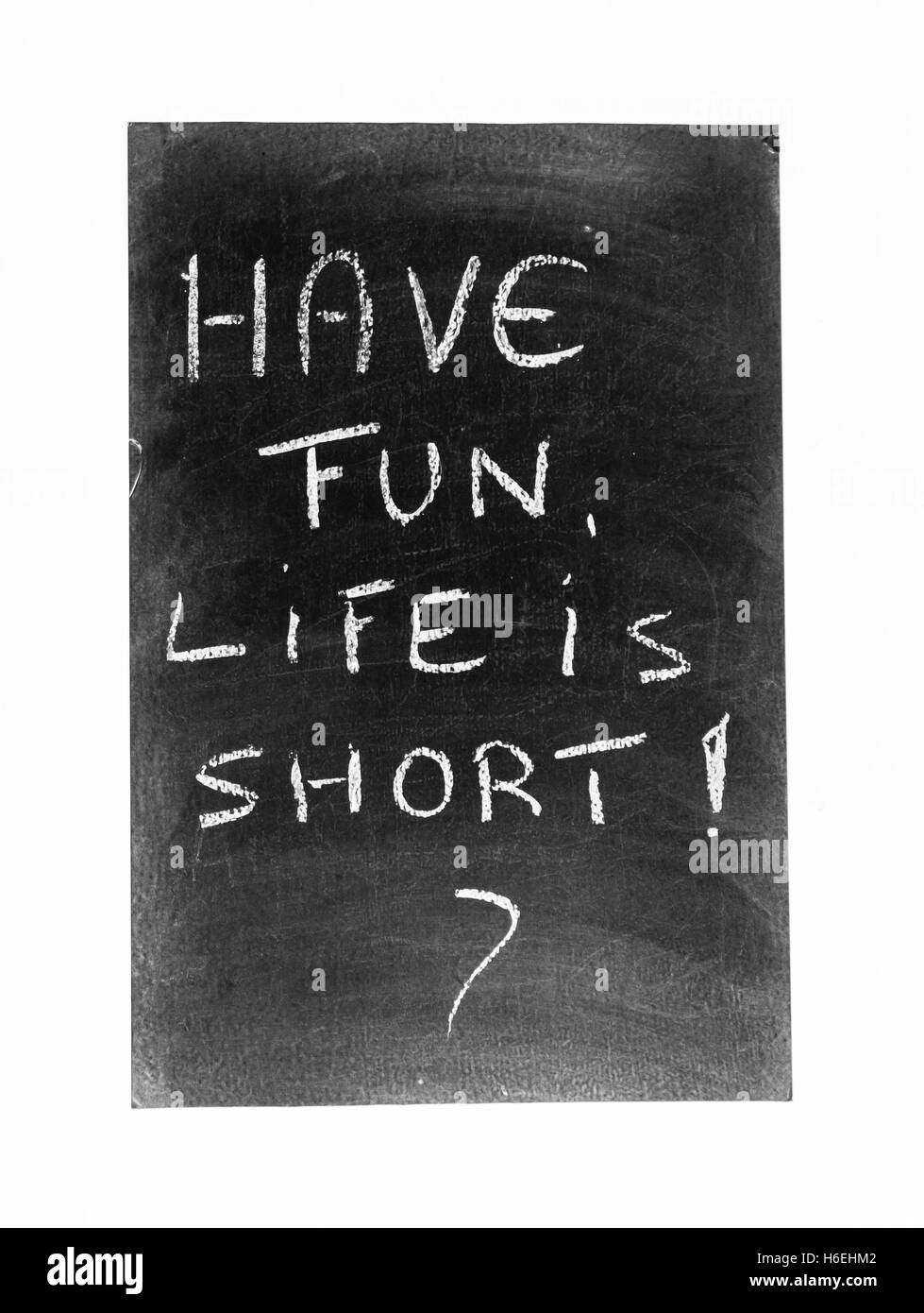 chalk board sign with handwritten chalk of have fun life is short - Stock Image