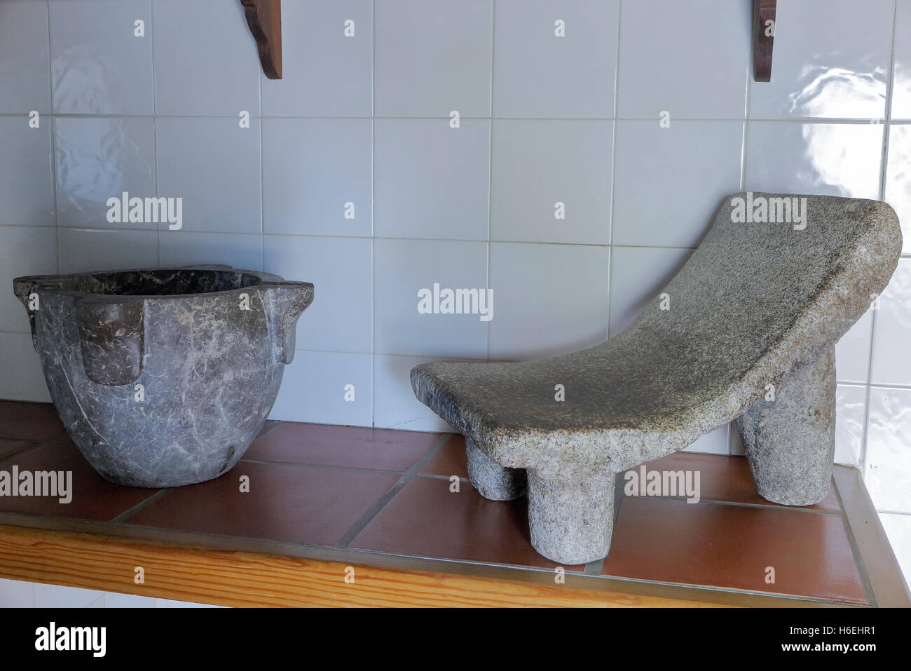 mortar and stone to knead in the kitchen Stock Photo