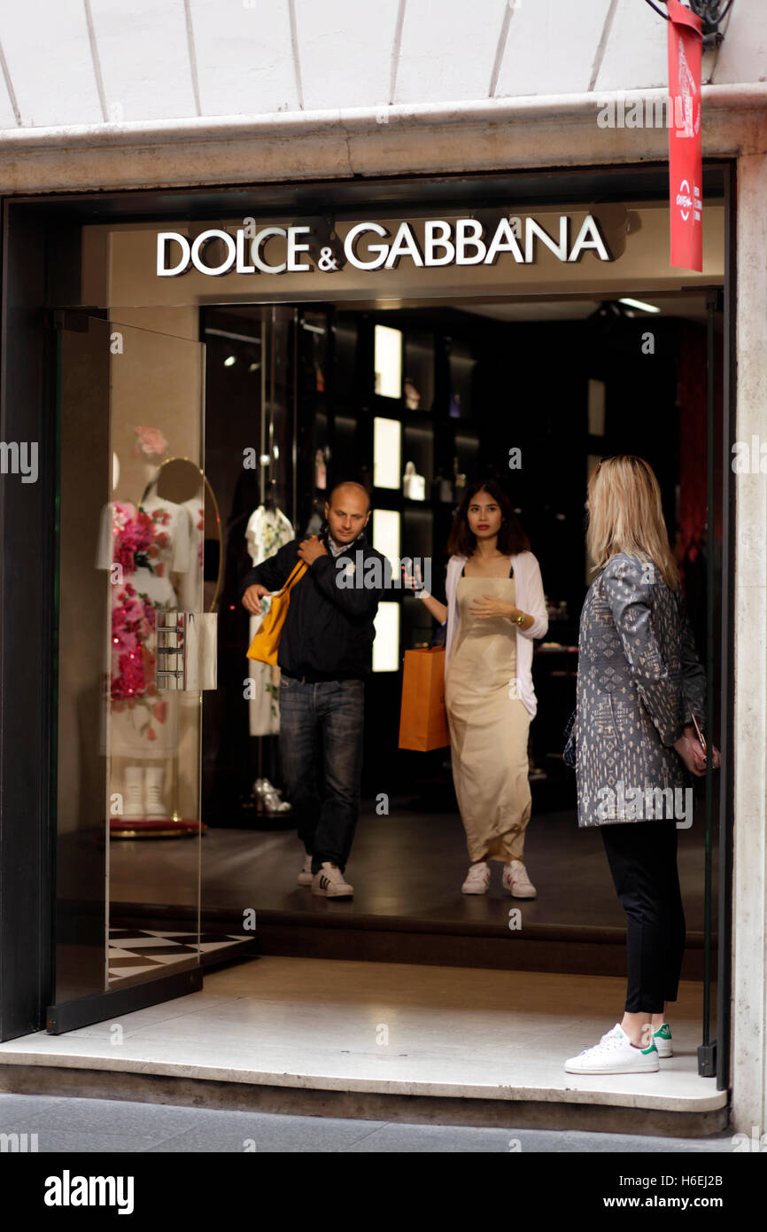 Pedestrian quit of the store with their Dolce & Gabbana shopping bag on Via del Corso, main shopping street - Stock Image