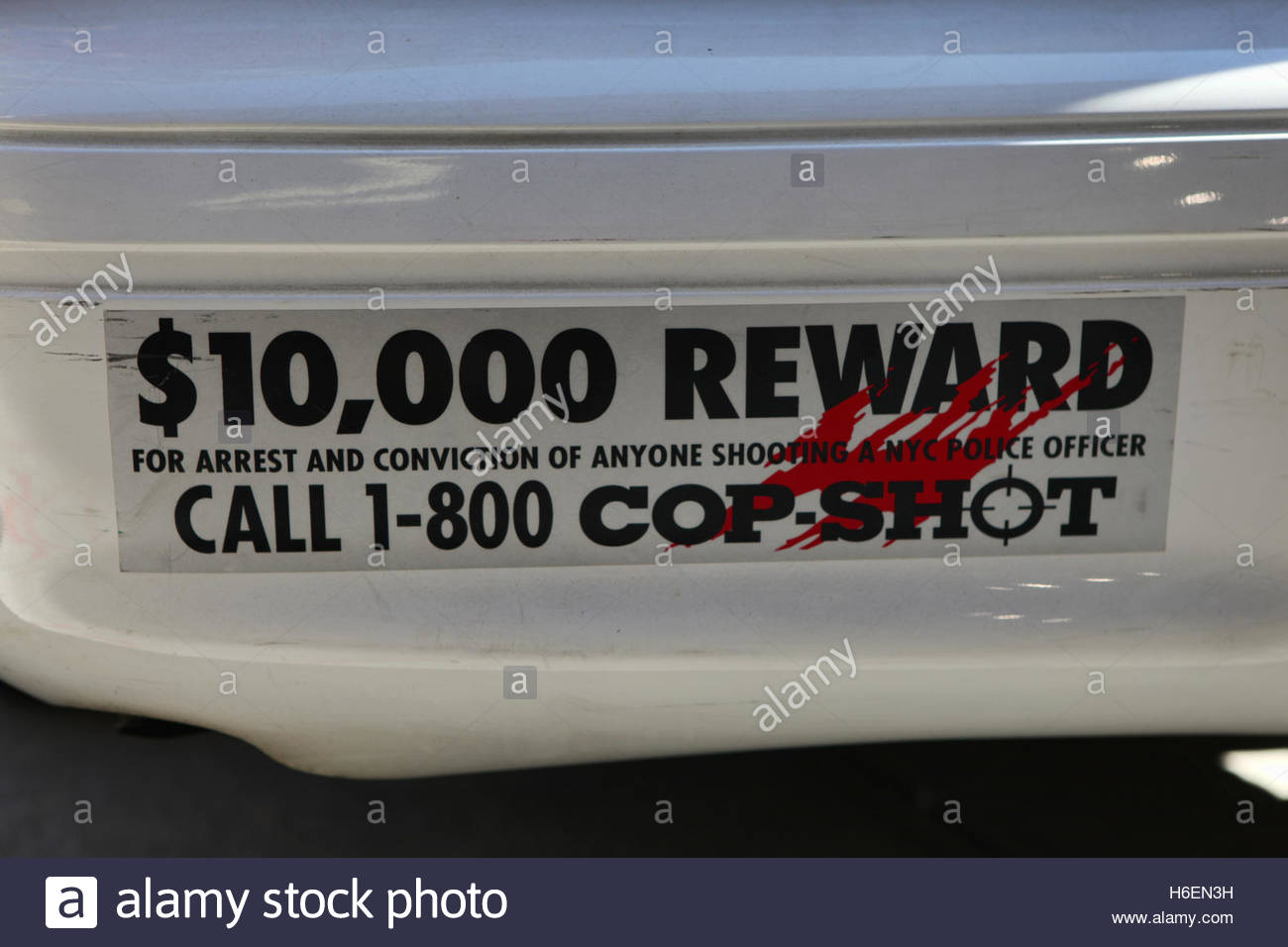 A bumper sticker on the back of a police car offering a ten thousand dollar reward for the arrest and conviction Stock Photo