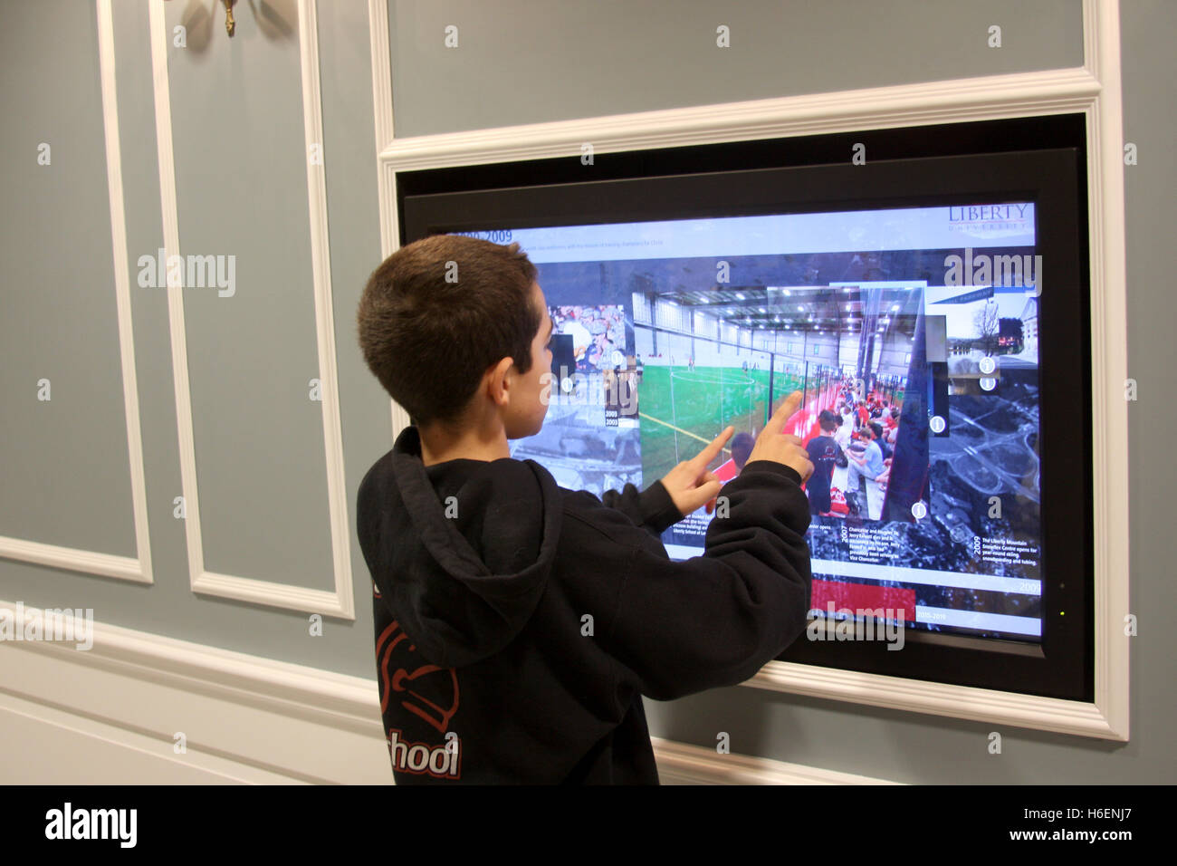 Large Touch Screen >> Young Boy Playing On A Large Touch Screen Display Inside